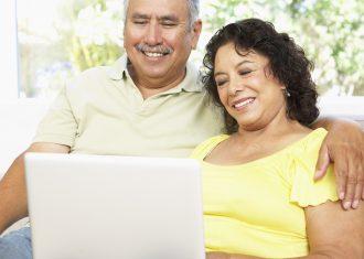 Senior Couple Using Laptop to set up retirement plan
